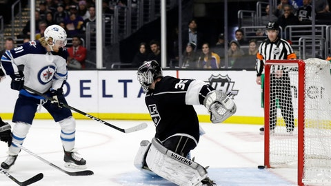 <p>               Winnipeg Jets' Kyle Connor, left, scores past Los Angeles Kings goaltender Jack Campbell, front right, during the first period of an NHL hockey game Monday, March 18, 2019, in Los Angeles. (AP Photo/Marcio Jose Sanchez)             </p>