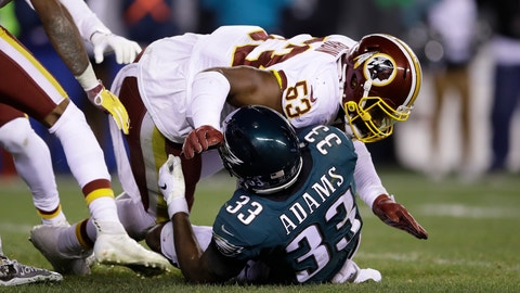 <p>               FILE - In this Monday, Dec. 3, 2018, file photo, Philadelphia Eagles' Josh Adams (33) is tackled by Washington Redskins' Zach Brown (53) on fourth down during the first half of an NFL football game, in Philadelphia. On Wednesday, March 13, 2019, the Redskins released linebacker Zach Brown and defensive lineman Stacy McGee as part of a remaking of their defense. (AP Photo/Matt Rourke, File)             </p>
