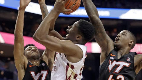 <p>               Florida State's Mfiondu Kabengele, center, shoots between Virginia Tech's Nickeil Alexander-Walker (4) and Ty Outlaw (42) during the first half of an NCAA college basketball game in the Atlantic Coast Conference tournament in Charlotte, N.C., Thursday, March 14, 2019. (AP Photo/Nell Redmond)             </p>