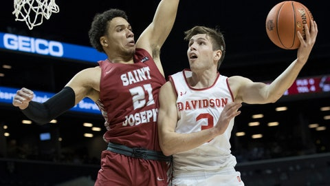 <p>               Davidson guard Jon Axel Gudmundsson (3) goes to the basket against Saint Joseph's forward Lorenzo Edwards (21) during the first half of an NCAA college basketball game in the Atlantic 10 Conference tournament, Friday, March 15, 2019, in New York. (AP Photo/Mary Altaffer)             </p>