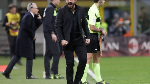 <p>               AC Milan coach Gennaro Gattuso celebrates his side's 1-0 win at the end of the Serie A soccer match between AC Milan and Sassuolo, at the San Siro stadium in Milan, Italy, Saturday, March 2, 2019. (AP Photo/Luca Bruno)             </p>