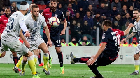 <p>               Cagliari's Leonardo Pavoletti , right, kicks the ball during the Serie A soccer match between Cagliari and Inter Milan at Sardegna Arena Stadium in Cagliari, Italy, Friday, March 1, 2019. (Fabio Murru/ANSA via AP)             </p>
