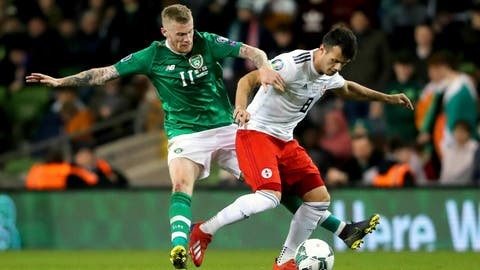 <p>               Republic of Ireland's James McClean, left, and Georgia's Valeri Qazaishvili in action during their UEFA Euro 2020 Qualifying, Group D soccer match at the Aviva Stadium in Dublin, Ireland, Tuesday March 26, 2019. (Niall Carson/PA via AP)             </p>
