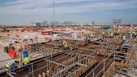 <p>               FILE  - In this Wednesday, Oct. 31, 2018 file photo, men work on the construction site of the Ras Abu Aboud stadium, backdropped by the city skyline in Doha, Qatar. A FIFA feasibility study concluded the 2022 World Cup can expand to 48 teams by using at least one of Qatar's neighbors as an additional host, and found there is a low legal risk to changing the format and an additional $400 million in revenue could be generated The Associated Press obtained a copy of the 81-page report on Monday, March 11, 2019 that assesses the political, logistical and legal issues surrounding adding 16 teams _ a significant change to the format more than eight years after Qatar won the hosting rights. (AP Photo/Vadim Ghirda, File)             </p>