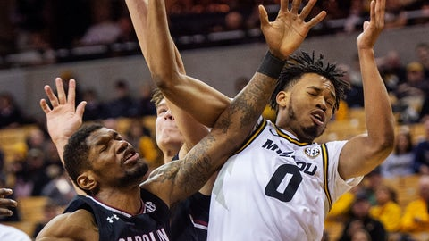 <p>               Missouri's Torrence Watson, right, and South Carolina's Chris Silva, left, battle for a rebound during the first half of an NCAA college basketball game Saturday, March 2, 2019, in Columbia, Mo. (AP Photo/L.G. Patterson)             </p>