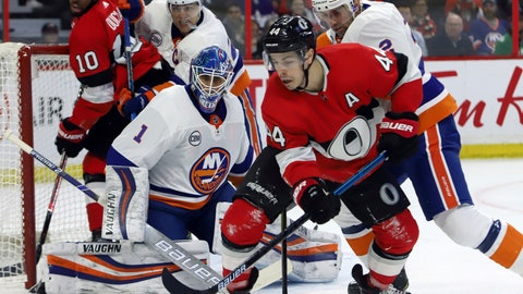 <p>               Ottawa Senators center Jean-Gabriel Pageau (44) tries to control the puck in front of New York Islanders goaltender Thomas Greiss (1) as Islanders defenseman Nick Leddy (2) defends during first-period NHL hockey game action in Ottawa, Ontario, Thursday, March 7, 2019. (Fred Chartrand/The Canadian Press via AP)             </p>