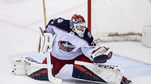 <p>               Columbus Blue Jackets goalie Sergei Bobrovsky, of Russia, reaches for a puck that went wide of the goal during the third period of an NHL hockey game against the Vancouver Canucks in Vancouver, British Columbia, Sunday, March 24, 2019. Columbus won, 5-0. (Darryl Dyck/The Canadian Press via AP)             </p>