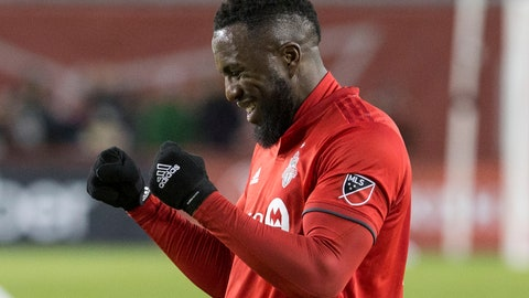 <p>               Toronto FC forward Jozy Altidore celebrates at the final whistle as his late goal sealed a 3-2 win over the New England Revolution in an MLS soccer match Sunday, March 17, 2019, in Toronto. (Chris Young/The Canadian Press via AP)             </p>