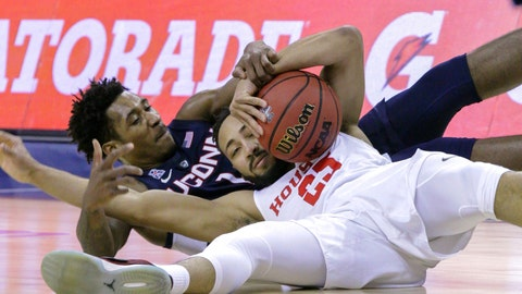 <p>               Connecticut guard Christian Vital and Houston's Galen Robinson Jr. scramble for a loose ball during the first half of an NCAA college basketball game at the American Athletic Conference tournament Friday, March 15, 2019, in Memphis, Tenn. (AP Photo/Troy Glasgow)             </p>