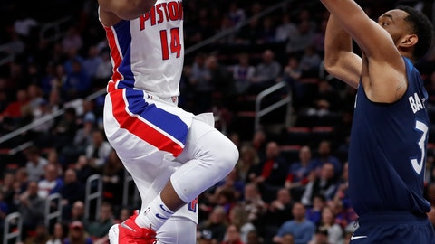 <p>               Detroit Pistons guard Ish Smith (14) shoots as Minnesota Timberwolves forward Keita Bates-Diop (31) defends during the first half of an NBA basketball game, Wednesday, March 6, 2019, in Detroit. (AP Photo/Carlos Osorio)             </p>