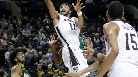 <p>               St. Bonaventure's Courtney Stockard (11) drives past George Mason's Otis Livingston II (4) during the first half of an NCAA college basketball game in the Atlantic 10 men's tournament Friday, March 15, 2019, in New York. (AP Photo/Frank Franklin II)             </p>