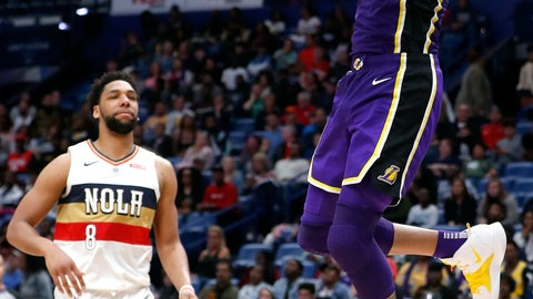 <p>               Los Angeles Lakers center JaVale McGee (7) dunks in front of New Orleans Pelicans center Jahlil Okafor (8) during the first half of an NBA basketball game in New Orleans, Sunday, March 31, 2019. (AP Photo/Tyler Kaufman)             </p>