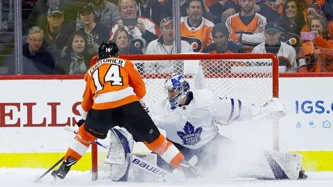 <p>               Philadelphia Flyers' Sean Couturier, left, scores past Toronto Maple Leafs' Frederik Andersen during the shootout in an NHL hockey game Wednesday, March 27, 2019, in Philadelphia. Philadelphia won 5-4. (AP Photo/Matt Slocum)             </p>