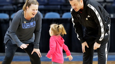 <p>               UCLA head coach Cori Close, left, reacts as the daughter of Louisville head coach Jeff Walz, center, runs on the court to greet her father, right, during  practice at the NCAA women's college basketball tournament, Thursday, March 28, 2019, in Albany, N.Y. UCLA faces UConn, and Louisville faces Oregon State in NCAA regional semifinal games on Friday. (AP Photo/Kathy Willens)             </p>
