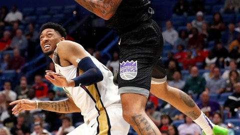 <p>               Sacramento Kings center Willie Cauley-Stein (00) grabs a rebound over New Orleans Pelicans forward Christian Wood (35) during the first half of an NBA basketball game in New Orleans, Thursday, March 28, 2019. (AP Photo/Tyler Kaufman)             </p>