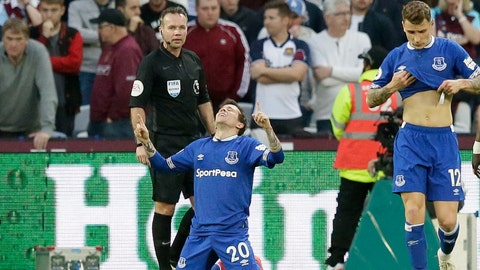<p>               Everton's Bernard kneels down celebrating after scoring his side's second goal during the English Premier League soccer match between West Ham United and Everton at London Stadium in London, Saturday, March 30, 2019. (AP Photo/Tim Ireland)             </p>