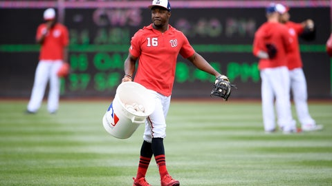 <p>               Washington Nationals center fielder Victor Robles (16) carries a bucket of baseballs before an exhibition baseball game against the New York Yankees, Monday, March 25, 2019, in Washington. (AP Photo/Nick Wass)             </p>