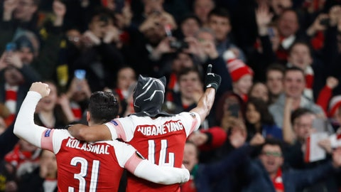 Arsenal's Pierre Emerick Aubameyang right celebrates after scoring his side's third goal during the Europa League round of 16 2nd leg soccer match between Arsenal and Rennes at the Emirates stadium in London Thursday March 1