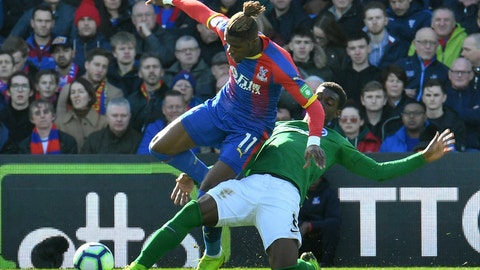 <p>               Crystal Palace's Wilfried Zaha, left, and Brighton & Hove Albion's Yves Bissouma in action during their English Premier League soccer match at Selhurst Park in London, Saturday March 9, 2019. (John Stillwell/PA via AP)             </p>