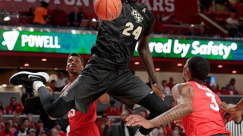 <p>               Central Florida center Tacko Fall (24) dunks over, from left to right, Houston forward Brison Gresham (55), forward Breaon Brady and guard Armoni Brooks (3) during the first half of an NCAA college basketball game Saturday, March 2, 2019, in Houston. (AP Photo/Michael Wyke)             </p>