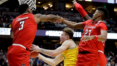 <p>               Michigan forward Ignas Brazdeikis, middle, drives to the basket between Texas Tech forward Deshawn Corprew, let, and guard Jarrett Culver during the first half an NCAA men's college basketball tournament West Region semifinal Thursday, March 28, 2019, in Anaheim, Calif. (AP Photo/Marcio Jose Sanchez)             </p>