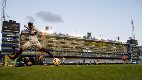 <p>               Boca Juniors' Yamila Rodriguez, below, fights for the ball with Lanus's Leila Garcia during the Superliga women's soccer tournament in Buenos Aires, Argentina, Saturday, March 9, 2019. The women competed in one of Argentina's most famous stadiums on Saturday, a milestone for the female players who are fighting for the same rights as male soccer players in the country's most popular sport. (AP Photo/Natacha Pisarenko)             </p>