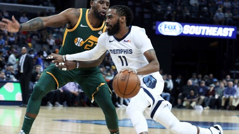 <p>               Memphis Grizzlies Mike Conley (11) drives past Utah Jazz's Royce O'Neale (23) during the first half of an NBA basketball game Friday, March 8, 2019, in Memphis, Tenn. (AP Photo/Karen Pulfer Focht)             </p>