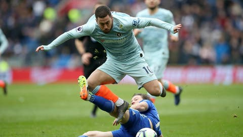 <p>               Chelsea's Eden Hazard, top, is fouled by Cardiff City's Harry Arter during their English Premier League soccer match at the Cardiff City Stadium, in Cardiff, Wales, Sunday March 31, 2019. (Nick Potts/PA via AP)             </p>