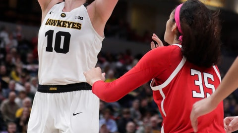 <p>               Iowa forward Megan Gustafson (10) shoots over Rutgers forward Stasha Carey (35) in the first half of an NCAA college basketball semifinal game at the Big Ten Conference tournament in Indianapolis, Saturday, March 9, 2019. (AP Photo/Michael Conroy)             </p>