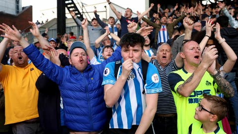 <p>               Huddersfield Town fans applaud their team after their relegation was confirmed after the English Premier League soccer match between Crystal Palace and Huddersfield Town at the Selhurst Park stadium, London. Saturday, March. 30, 2019 (Isabel Infantes/PA via AP)             </p>