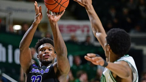 <p>               Buffalo forward Nick Perkins shoots a 3-pointer gainst Ohio forward Doug Taylor during the first half of an NCAA college basketball game Tuesday, March 5, 2019, in Athens, Ohio. (AP Photo/David Dermer)             </p>