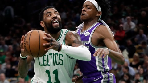 <p>               Boston Celtics guard Kyrie Irving (11) drives against Sacramento Kings guard De'Aaron Fox in the first half of an NBA basketball game, Thursday, March 14, 2019, in Boston. (AP Photo/Elise Amendola)             </p>
