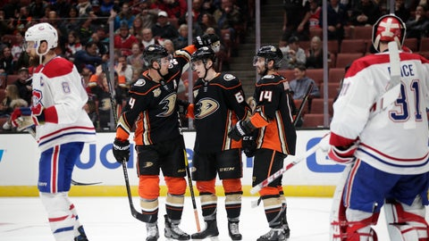 <p>               Anaheim Ducks' Troy Terry, center, is congratulated by Cam Fowler, left, and Adam Henrique after he scored a goal against Montreal Canadiens goaltender Carey Price during the second period of an NHL hockey game Friday, March 8, 2019, in Anaheim, Calif. (AP Photo/Jae C. Hong)             </p>