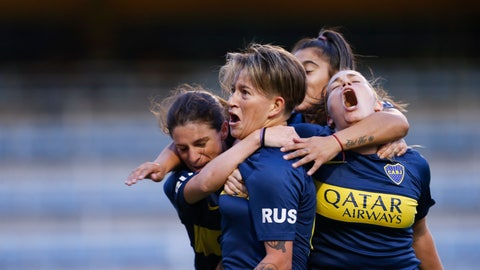 <p>               Boca Juniors' Yamila Rodriguez, center, celebrates with teammates after scoring in the Superliga women's soccer tournament in Buenos Aires, Argentina, on Saturday, March 9, 2019. The women competed in one of Argentina's most famous stadiums on Saturday, a milestone for the female players who are fighting for the same rights as male soccer players in the country's most popular sport. (AP Photo/Natacha Pisarenko)             </p>