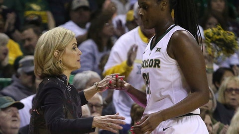 <p>               Baylor head coach Kim Mulkey thanks Baylor center Kalani Brown (21) as she head to the bench in the second half of an NCAA college basketball game, Saturday, March 2, 2019, in Waco, Texas. Baylor defeated Oklahoma State 76-44. (AP Photo/Jerry Larson)             </p>