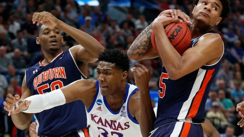 <p>               Auburn's Chuma Okeke (5) grabs a rebound from Kansas forward David McCormack (33) as Auburn's Austin Wiley (50) watches during the first half of a second-round game in the NCAA men's college basketball tournament Saturday, March 23, 2019, in Salt Lake City. (AP Photo/Rick Bowmer)             </p>