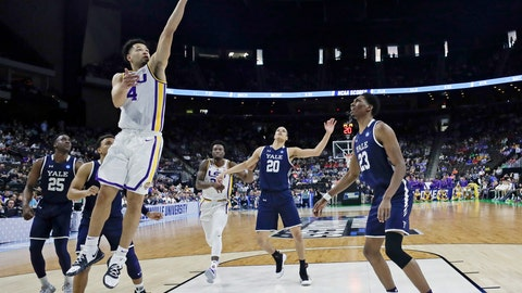 <p>               LSU's Skylar Mays (4) goes up for a shot over Yale 's Paul Atkinson (20) and Jordan Bruner (23) during the first half of a first round men's college basketball game in the NCAA Tournament in Jacksonville, Fla., Thursday, March 21, 2019. (AP Photo/John Raoux)             </p>