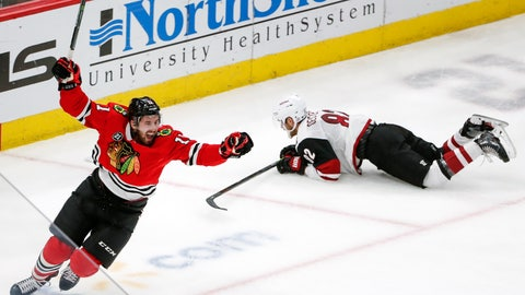<p>               Chicago Blackhawks left wing Brendan Perlini (11) celebrates after scoring against the Arizona Coyotes during the third period of an NHL hockey game Monday, March 11, 2019, in Chicago. (AP Photo/Kamil Krzaczynski)             </p>