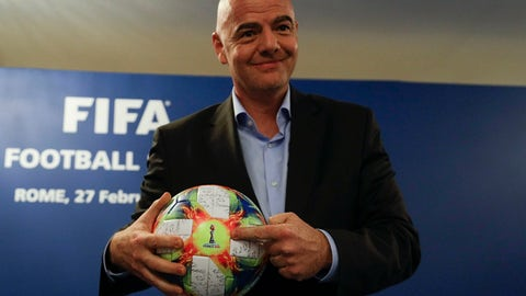 <p>               FIFA President Gianni Infantino holds the official ball of the upcoming Women's Soccer World Championship as he poses for photographers during a press conference at the end of an executive committee meeting in Rome, Wednesday, Feb. 27, 2019. (AP Photo/Gregorio Borgia)             </p>