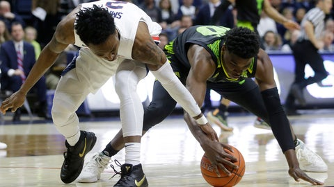 <p>               Connecticut's Tarin Smith, left, and South Florida's Alexis Yetna, right, vie for a loose ball during the first half of an NCAA college basketball game, Sunday, March 3, 2019, in Storrs, Conn. (AP Photo/Steven Senne)             </p>