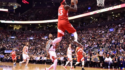 <p>               Toronto Raptors forward Pascal Siakam (43) scores as Chicago Bulls guard Wayne Selden (14) looks on during the second half of an NBA basketball game in Toronto on Tuesday, March 26, 2019. (Frank Gunn/The Canadian Press via AP)             </p>