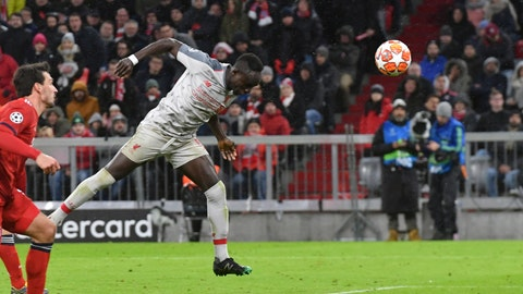 <p>               Liverpool midfielder Sadio Mane, second left, scores his side's third goal during the Champions League round of 16 second leg soccer match between Bayern Munich and Liverpool at the Allianz Arena, in Munich, Germany, Wednesday, March 13, 2019. (AP Photo/Kerstin Joensson)             </p>