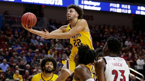 <p>               Minnesota's Gabe Kalscheur (22) goes for a layup as Louisville's Steven Enoch (23) watches, during the second half of a first round men's college basketball game in the NCAA Tournament in Des Moines, Iowa, Thursday, March 21, 2019. (AP Photo/Nati Harnik)             </p>