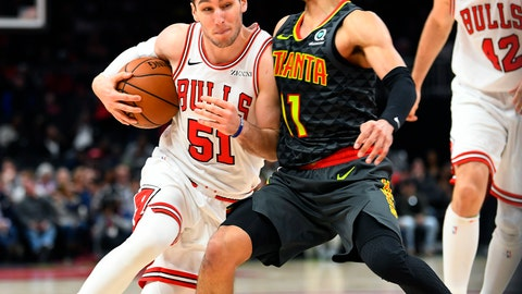 <p>               Chicago Bulls guard Ryan Arcidiacono (51) comes up against the defense of Atlanta Hawks guard Trae Young as he drives the lane during the first half of an NBA basketball game Friday, March 1, 2019, in Atlanta. (AP Photo/John Amis)             </p>