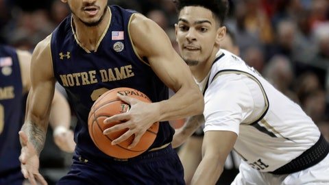 <p>               Notre Dame's Prentiss Hubb, left, drives past Georgia Tech's Jose Alvarado, right, during the first half of an NCAA college basketball game in the Atlantic Coast Conference tournament in Charlotte, N.C., Tuesday, March 12, 2019. (AP Photo/Nell Redmond)             </p>