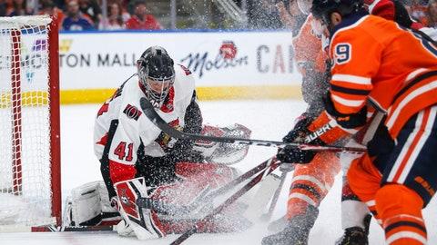 <p>               Ottawa Senators goaltender Craig Anderson (41) makes a save against Edmonton Oilers' Sam Gagner (89) during second-period NHL hockey game action in Edmonton, Alberta, Saturday, March 23, 2019. (Jeff McIntosh/The Canadian Press via AP)             </p>