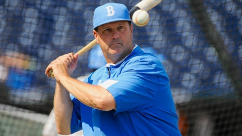 <p>               FILE - In this June 14, 2013, file photo, UCLA coach John Savage eyes the ball during NCAA college baseball practice at TD Ameritrade Park in Omaha, Neb. The Bruins, who have had to shuffle their pitching rotation because of injuries, are No. 1 in the country after taking two of three games against defending national champion Oregon State over the weekend. (AP Photo/Eric Francis, File)             </p>