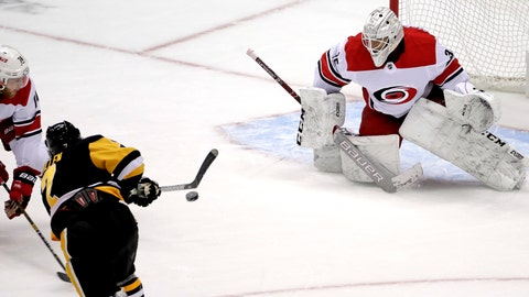 <p>               Pittsburgh Penguins' Matt Cullen (7) gets a shot past Carolina Hurricanes goaltender Curtis McElhinney (35) for a goal with Hurricanes' Jaccob Slavin (74) defending during the first period an NHL hockey game in Pittsburgh, Sunday, March 31, 2019. (AP Photo/Gene J. Puskar)             </p>
