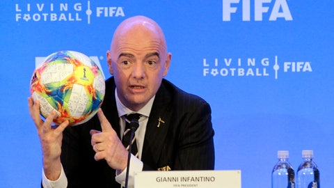 <p>               FIFA President Gianni Infantino holds a soccer ball as he speaks during a press conference after the FIFA Council Meeting, Friday, March 15, 2019, in Miami. The council approved working with Qatar to explore expanding the 2022 World Cup to 48 teams by adding at least one more country in the Persian Gulf to host matches. (AP Photo/Luis M. Alvarez)             </p>