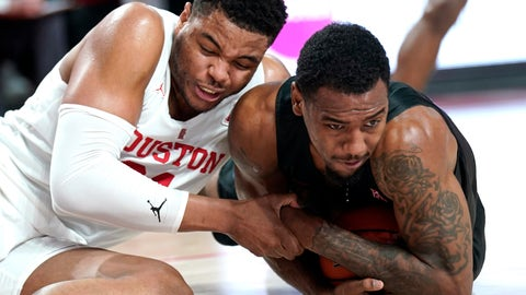 <p>               Houston's Breaon Brady, left, and Southern Methodist's Isiaha Mike reach for a loose ball during the first half of an NCAA college basketball game Thursday, March 7, 2019, in Houston. (AP Photo/David J. Phillip)             </p>